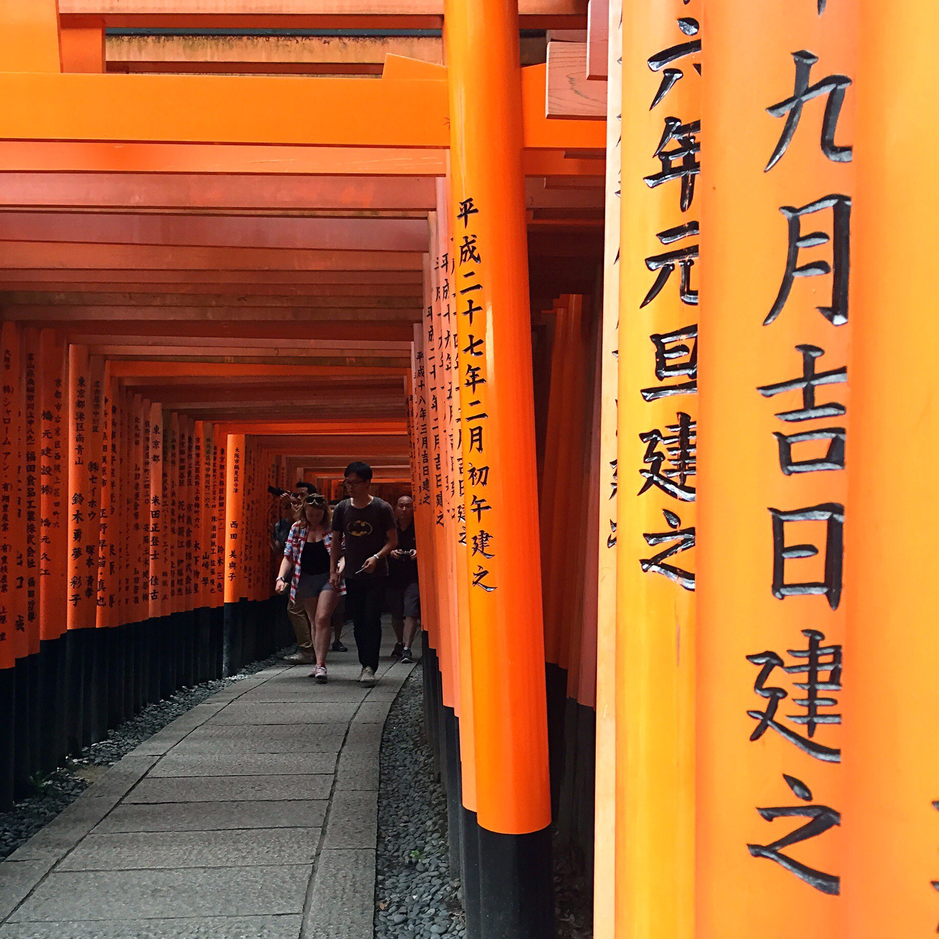 The names of individuals, businesses and celebrities are inscribed on the pillars of the torii gates.