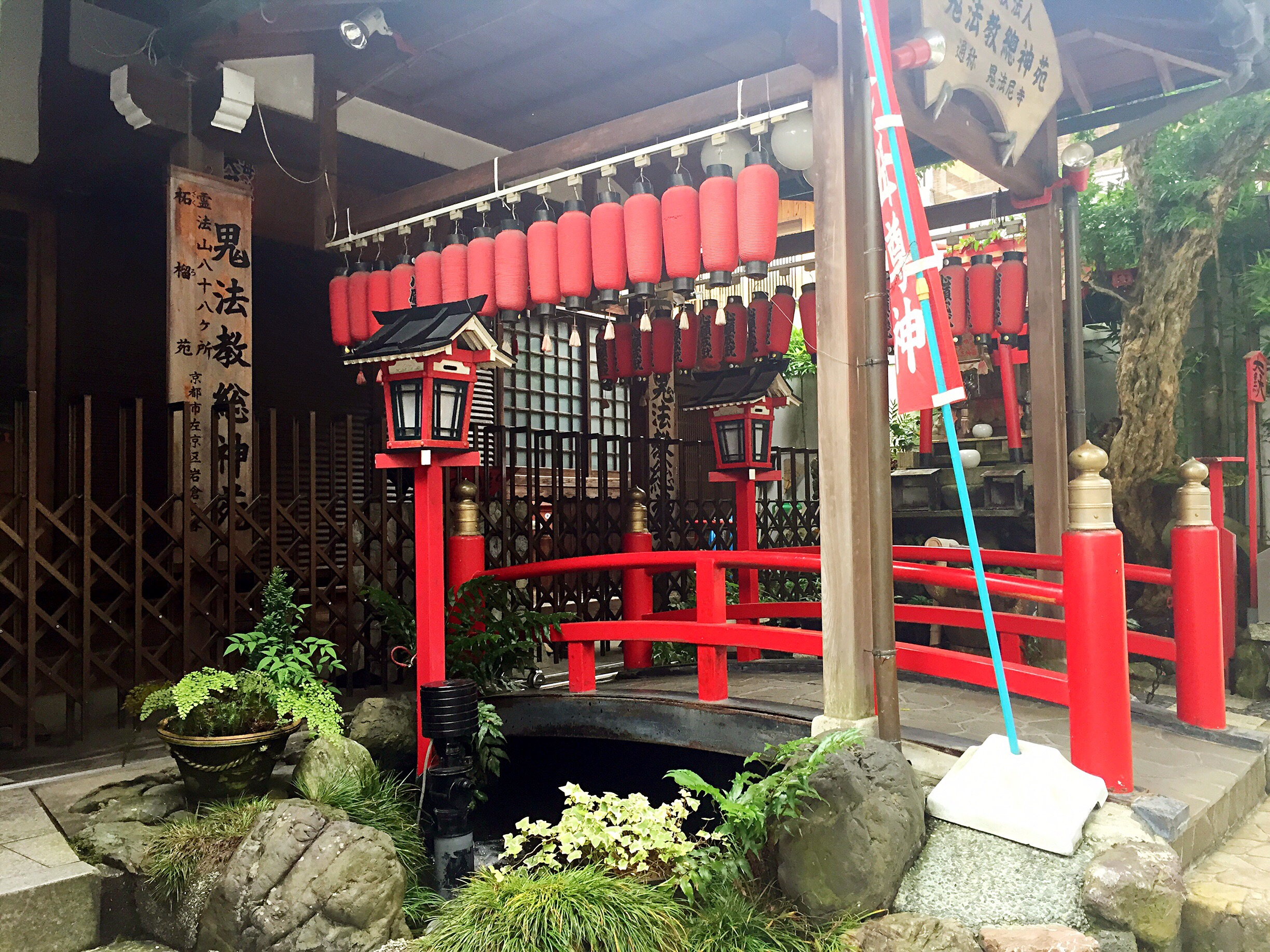 Small shop at shrine with bridge
